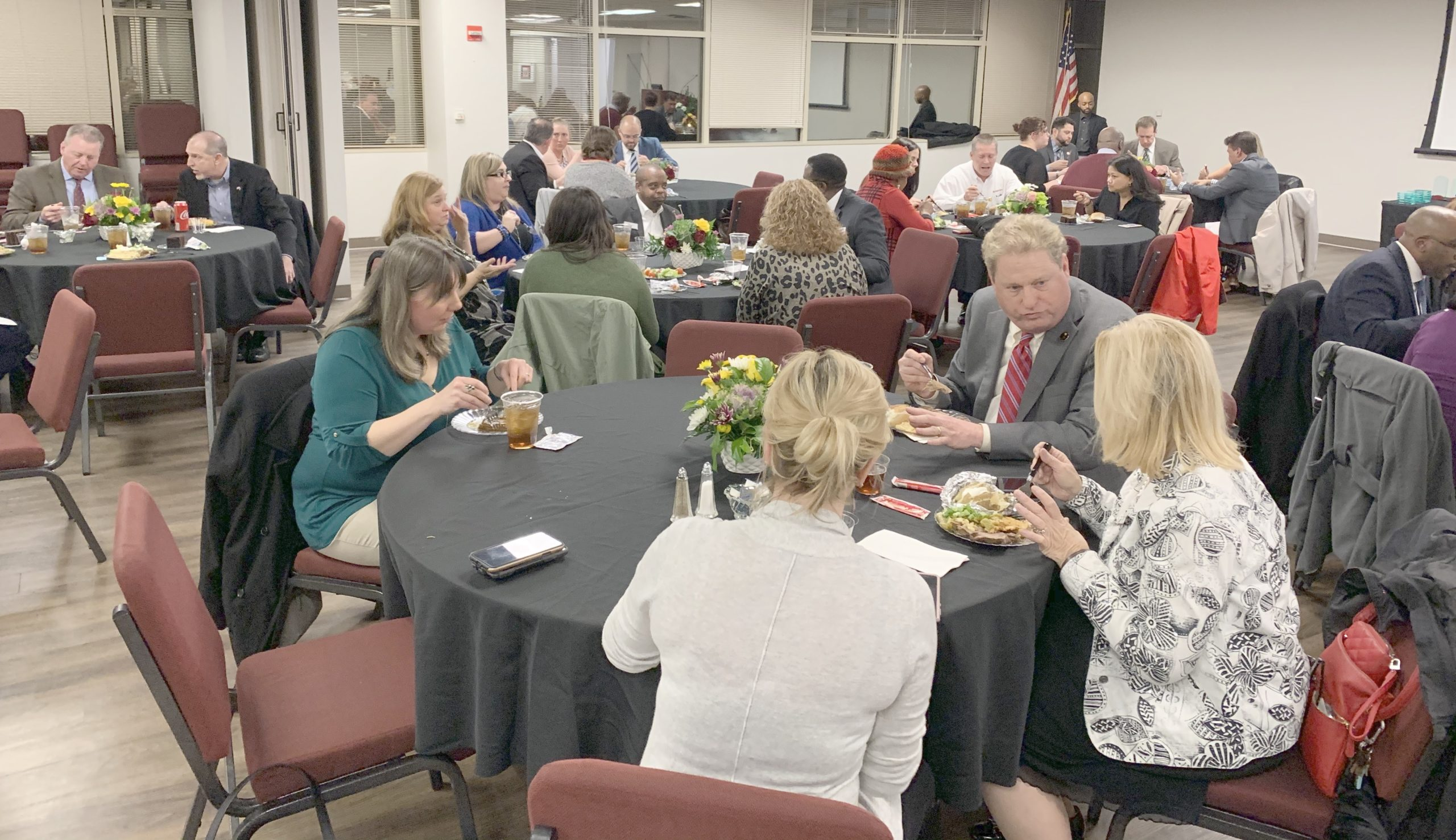 Banquet photo of members networking over dinner