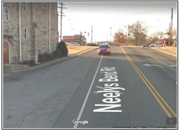 Google's camera captures a car crossing over the line from Neely's Bend Road (near Gallatin Pike) into an undefined paved area where people sometimes walk adjacent to City Road Chapel. Due to the lack of curb and gutter, ill-defined roads can cause hazardous conditions for drivers and pedestrians.